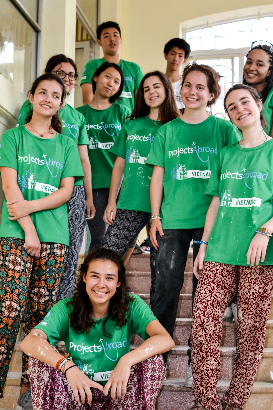 An international group of Projects Abroad volunteers take a break during their high school special project.